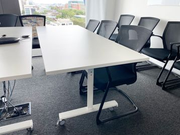 Used white folding reconfigurable tables in excellent condition