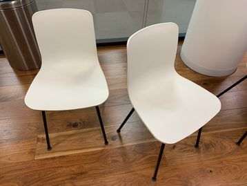 Used Vitra HAL TUBE chairs with white shell and black legs.
