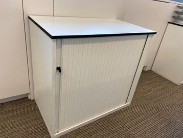 White side tambour door storage cupboards with shelves
