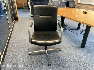 Used Executive swivel meeting chairs upholstered in high-grade soft black leather