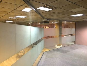 An example of a recent glass partitioning installation with opaque manifestations