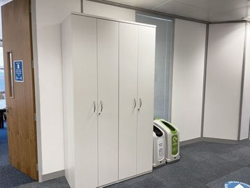 Used white double-door coat cupboards.