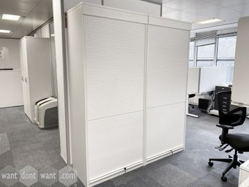 Used white tall vertical tambour door storage cupboards with shelves.
