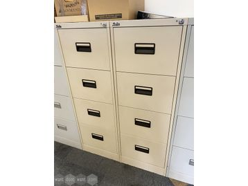 Used Silverline 4-drawer cream filing cabinets.