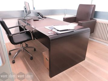 Large executive desks in dark wood veneer with leather inlay top.