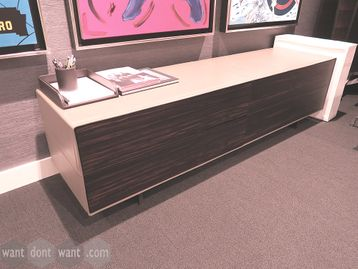 Used credenza unit with cream leather carcass and sliding walnut doors