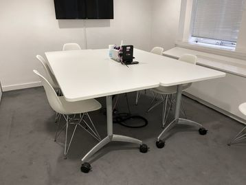 Used Senator white folding tables with silver legs.