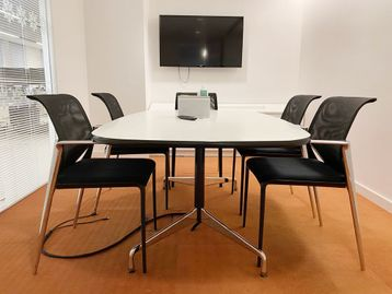 Used Vitra/Eames 'Segmented Table' with white laminate top, black edge.