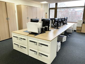 15x Used 6-person bench desks with oak tops and white legs