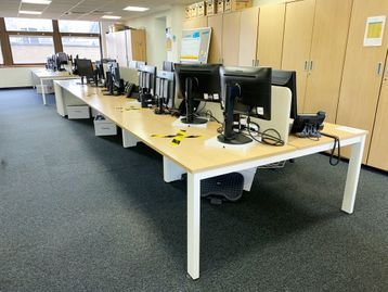 3 x Used 8-person bench desks with oak tops and white legs.