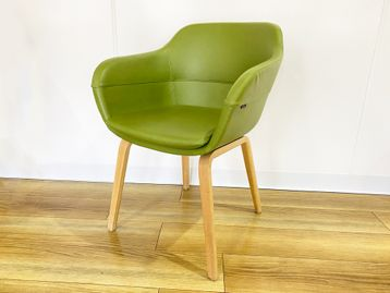 Used 'Brunner' green leather armchair with oak legs