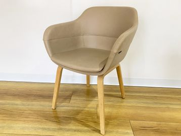 Used 'Brunner' fawn leather armchair with oak legs