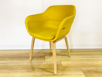 Used 'Brunner' yellow leather armchair with oak legs