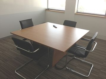 Cherry meeting tables with panel ends.