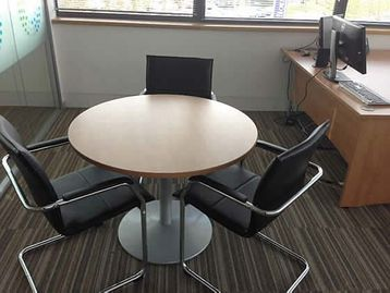 Circular cherry meeting table with silver base