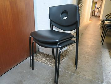 Modern stacking chairs with black vinyl seat and plastic back