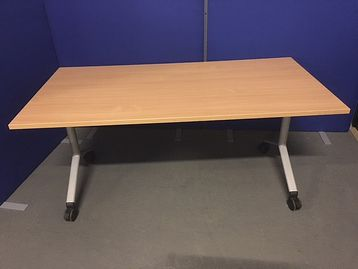 Flip-top tables in beech finish with light grey legs on castors