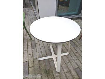 Used contemporary circular table with white top and base.
