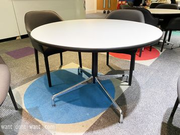 Used Vitra 'Segmented Tables'. White tops with black edge and the classic chrome Eames base.