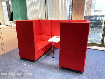 Used Sven Christiansen 'XRMH' Meeting Booth in red fabric. Includes a fixed central white table.