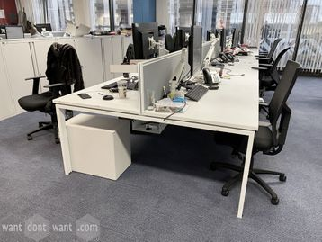 Used white bench desks in various configurations and sizes.