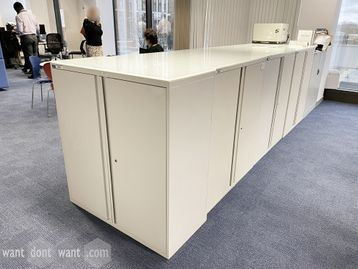 Used white double door 'Maine' storage cupboards with shelves and opaque glass tops