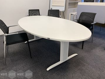 Used white oval meeting table with white metal legs