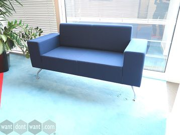 Used Orangebox sofa upholstered in blue fabric.