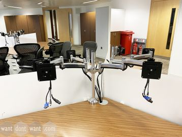 Used dual monitor arms in chrome finish