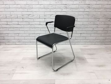Used Patra Amigo Series Stacking Chair with arms.