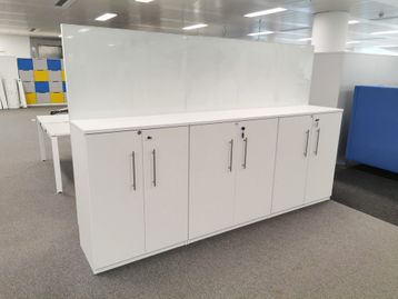 3-Bank, medium height storage with high dry wipe glass screen attached.