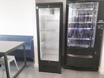 Used tall glass-fronted drinks fridge with black carcass