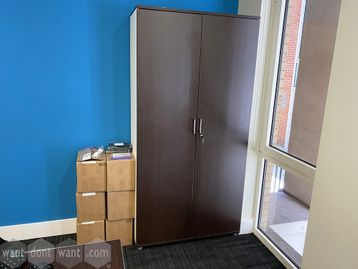 Used tall double-door wardrobe/storage cupboards with half hanging rail and half shelves.