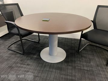 Used Circular Meeting Tables with wenge veneer tops and silver grey column base.