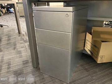 Used slimline 3-drawer under-desk mobile pedestal in raw steel look - very nice!