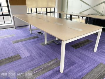5 x Used 6-person light oak bench desks. Each desk position measures 1300mm wide x 683mm deep.