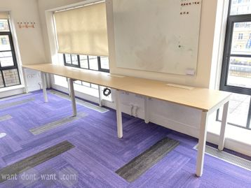 Used 4-person side-by-side bench desk. Each desk position 1200mm wide x 670mm deep.