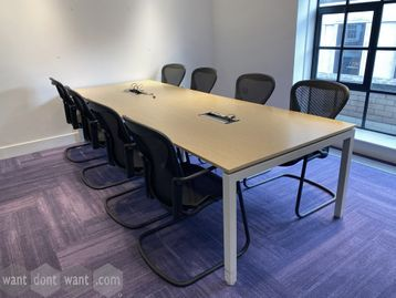 Used 10-person meeting table in oak MFC. 3200mm wide x 1140mm deep.
