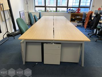 3 x Used 8-person sliding-top bench desks 1400mm wide x 800mm deep.