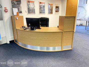 Used light oak curved-front reception desk.