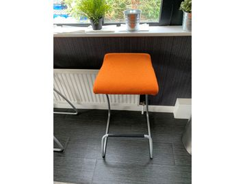 Used Steelcase 'Spring' cantilever stools with orange fabric seat.