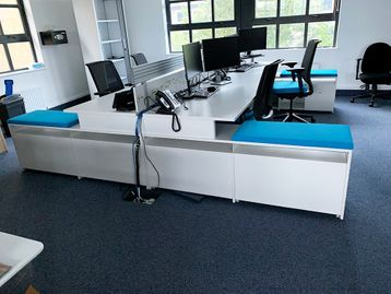 Excellent used 4-person Steelcase 'Fusion' bench desks with supporting storage to the outer side