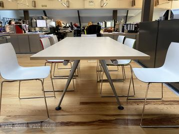 Used Herman Miller 'Abak' maple top meeting table with silver splayed legs