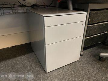 Used under-desk light grey pedestals.