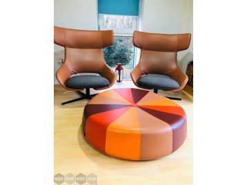 Unique opportunity to purchase 2 x used Artifort 'Kalm' chairs in tan hide together with a multi-coloured leather LaCividina 'Windmill' ottoman by Constance Guisset