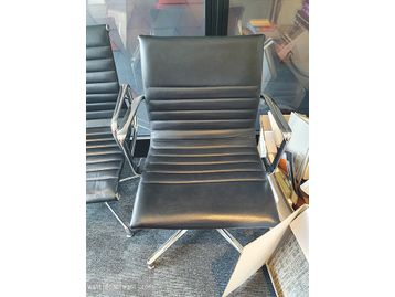 Used meeting chairs with chrome frame and ribbed black leather upholstery