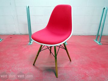 Used Vitra DSW Plastic Side Chair with red upholstery and golden maple legs.