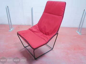 Used Viccarbe 'Ace' lounge chair upholstered in red fabric with black steel base.