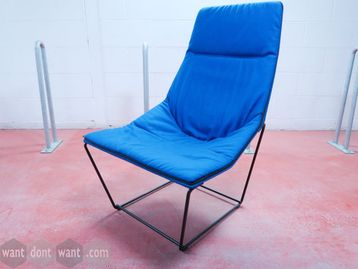 Used Viccarbe 'Ace' lounge chair upholstered in bright blue fabric with black steel base.