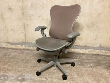 Used Herman Miller 'Mirra' chairs with dusky pink mesh back, grey mesh seat and light grey frame.